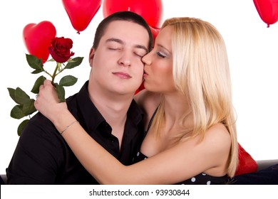 man and woman in love with red rose