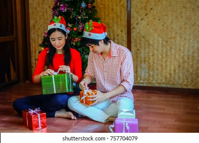 man and woman making a the gift for children and prepare house for Christmas and new year party. holiday celebration concept.