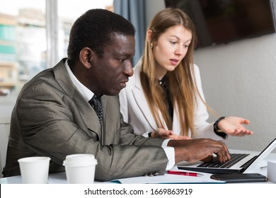Man and woman managers  with laptop working and drink coffee in office