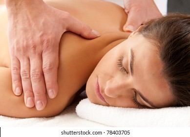Man woman massage relax treatment close-up  portrait from male hands