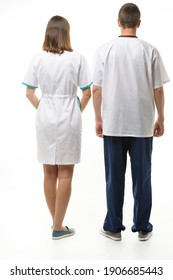 A man and a woman in medical clothes stand with their backs, full height