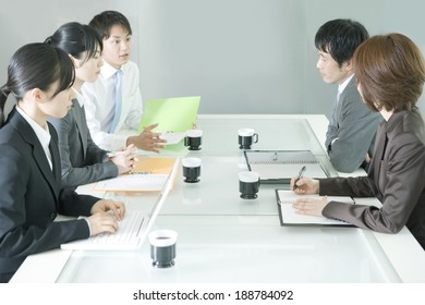 man and woman in meeting