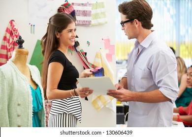 Man And Woman Meeting In Fashion Design Studio