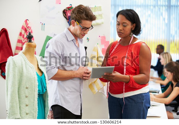 Man And Woman Meeting In Fashion Design Studio