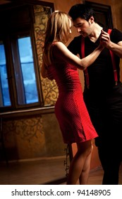 A man and a woman in the most romantic dance: tango. Please see more images from the same shoot.
