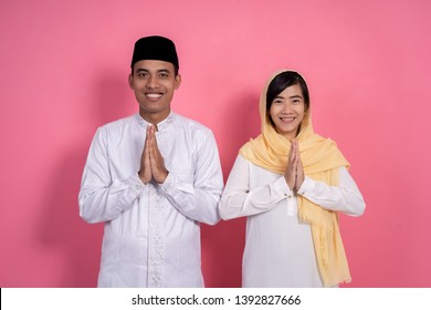 man and woman muslim greeting on studio smiling to camera