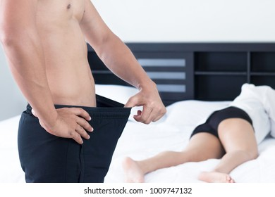 Man and woman on bed, Unhappy young couple on the bed in bedroom, Family concept.
