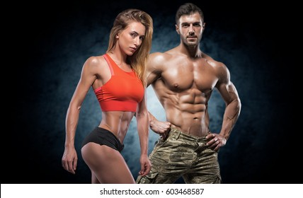 Man and woman on a dark background. Fitness couple.