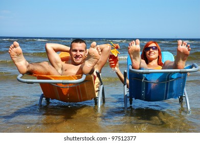 Man and woman on the  deck-chair