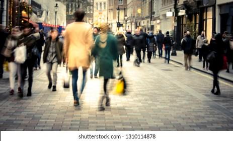 Man & woman on high street shopping scene