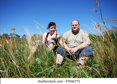 man and woman outdoors