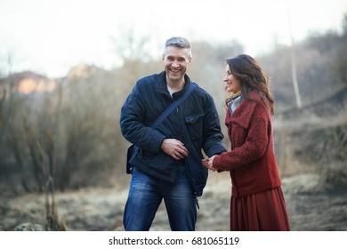 man and woman outdoors playing, fun, joy