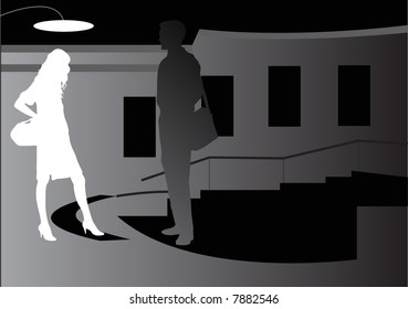man and woman outside building at night