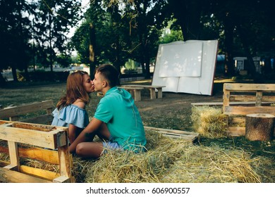 man and woman in a park posing on camera