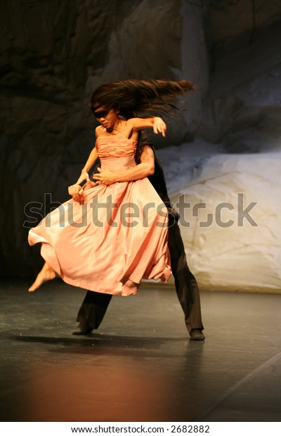 man and woman performing during the pina bausch show