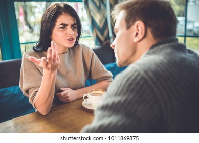 The man and woman quarreling in the restaurant