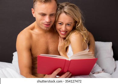 Man and woman reading book together