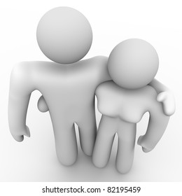 A man and a woman, representing husband and wife or boyfriend and girlfriend, stand together in a loving embrace demonstrating a loving, passionate relationship