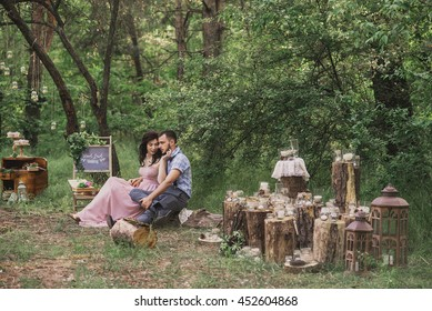 Man and woman in retro styled wear pose in the vintage decorations outdoor