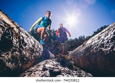 Man and woman running on the mountain. Area of Madrid Spain.