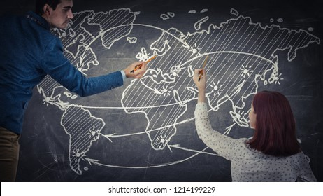 Man and woman sharing thoughts together drawing a world map on a blackboard. Future journey planning, people idea exchange, business partnership and teamwork innovation concept.