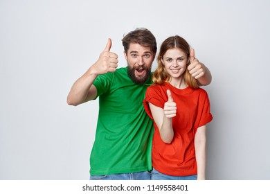 A man and a woman show T-shirts OK.