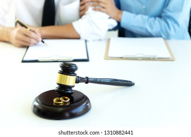 man and woman sit together with romantic to sign paper in the lawer room