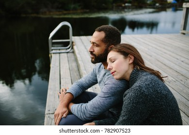 Man and woman sitting on a dock