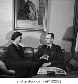 Man and woman sitting on sofa and talking