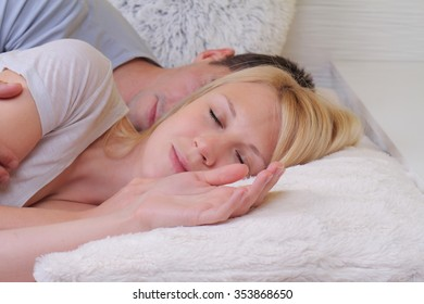 Man and woman sleeping together, couple in bed. Love, rest, family and happiness concept