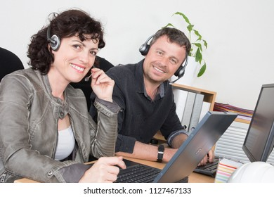 man and woman smile happy in help support call center office