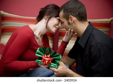 man and woman smiling and holding each other