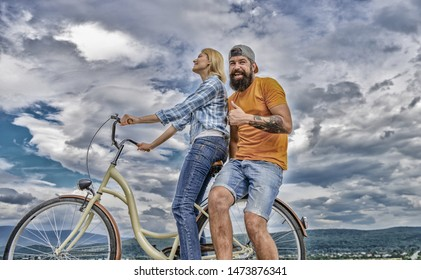 Man and woman spend active leisure with bike. Couple in love date outdoors cycling. Bike rental or bike hire for short periods of time. Date ideas. Couple with bicycle romantic date sky background.