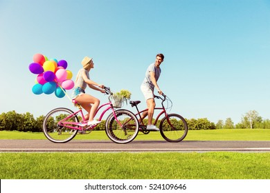 Man and woman spending time together and riding bicycles