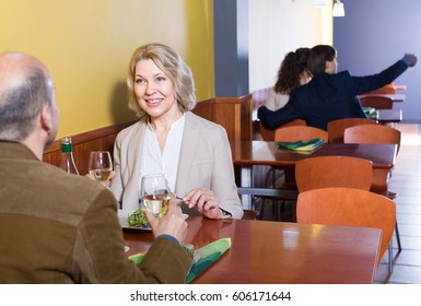 man and woman spending time together in restaurant