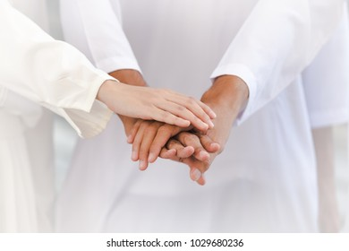 man and woman stacking hands working teamwork in city