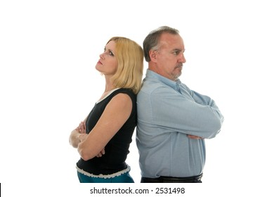 Man and woman standing back to back in an argument.