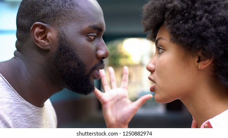Man and woman talking aggressively outdoor, relation difficulties, conflict