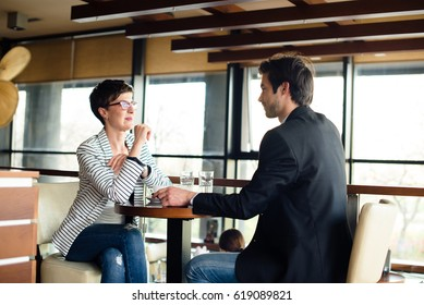 Man and woman talking on business meeting
