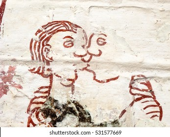 Man and woman tender kissing. One of  the seven deadly sins: Lust. (Luxoria)  Medieval fresco in a Araslov church, Sweden. Sept 03, 2010,