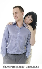 man and woman together laughing. She hugs his shoulders