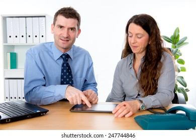 man and woman together in the office