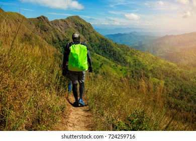 Man and woman traveler with backpack trekking mountain