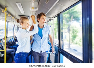 man and woman traveling by bus