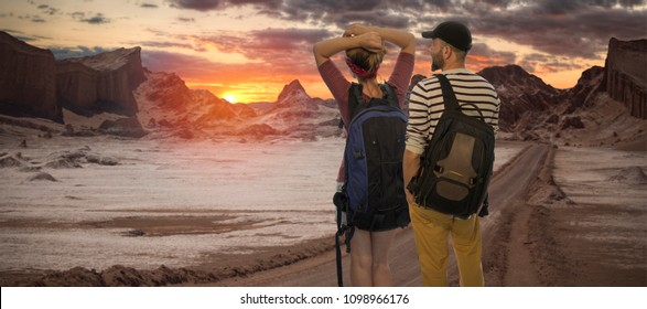 A man with a woman travels through the Atacama Desert in Chile.