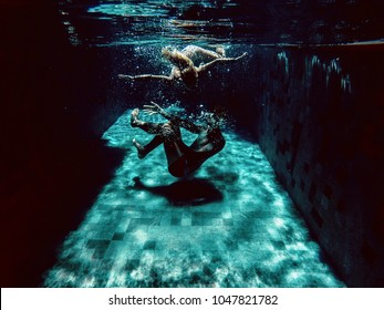 man and woman under water