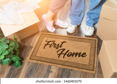 Man and Woman Unpacking Near First Home Welcome Mat, Moving Boxes and Plant.