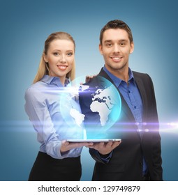 man and woman with virtual globe from tablet pc