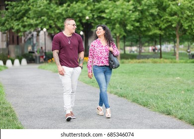Man and woman walking down pathway