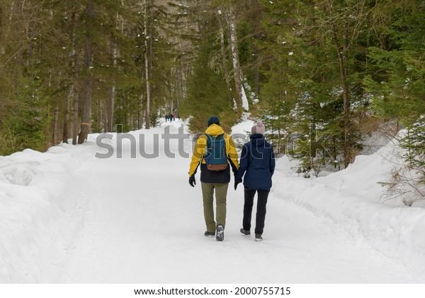 man-woman-walking-together-along-600w-20